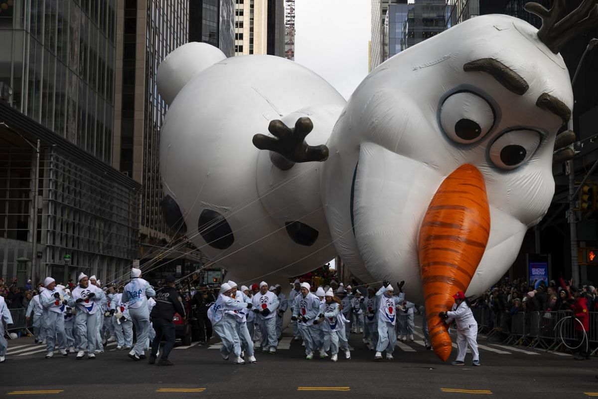 Handlers struggle with the Olaf balloon as unpredictable winds pushed it off course during the Macy's Thanksgiving Day Parade in New York, on Nov 28, 2019.
