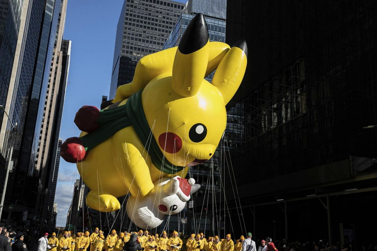 A Pikachu balloon makes its way down New York's Sixth Avenue during the Macy's Thanksgiving Day Parade, on Nov 28, 2019, in New York.
