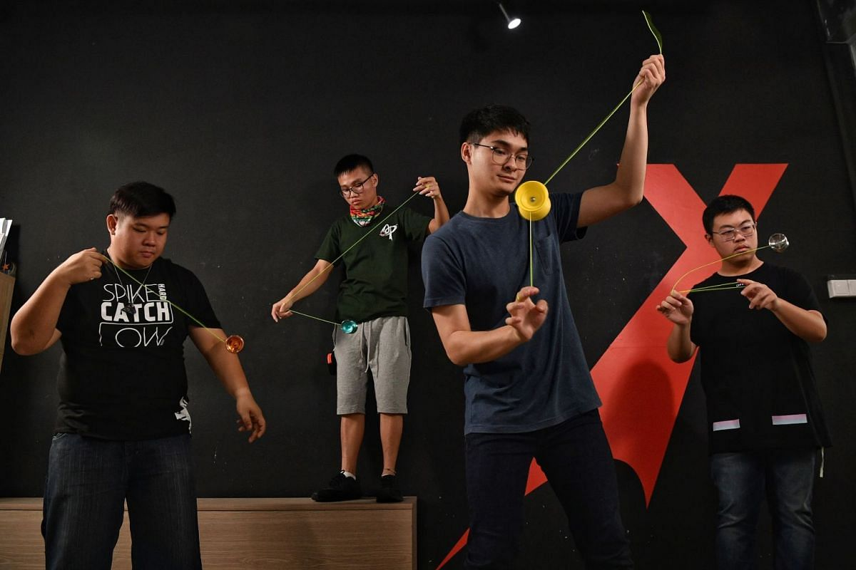 Spinners (from far left) Kenneth Bay, Bryan Teo, Wee Teng Ee and Jeremy Soo doing tricks at Spinworkx. Regarded as the only yo-yo authority here, the store at Orchard Central is where enthusiasts meet every Saturday.