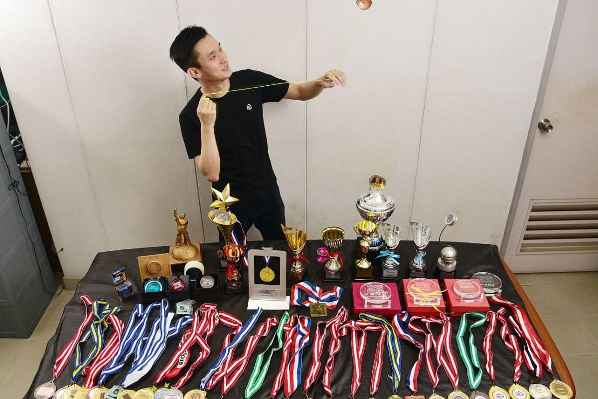 Mr Marcus Koh with his bevy of medals won at national and world yo-yo competitions over the years.