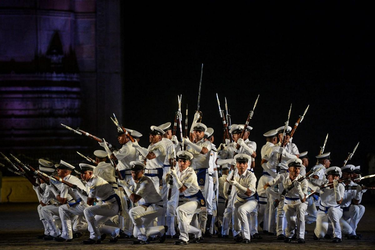 Indian Navy sailors take part in a rehearsal for the forthcoming Navy Day celebrations at the Gateway of India in Mumbai, on Dec 1, 2019.
