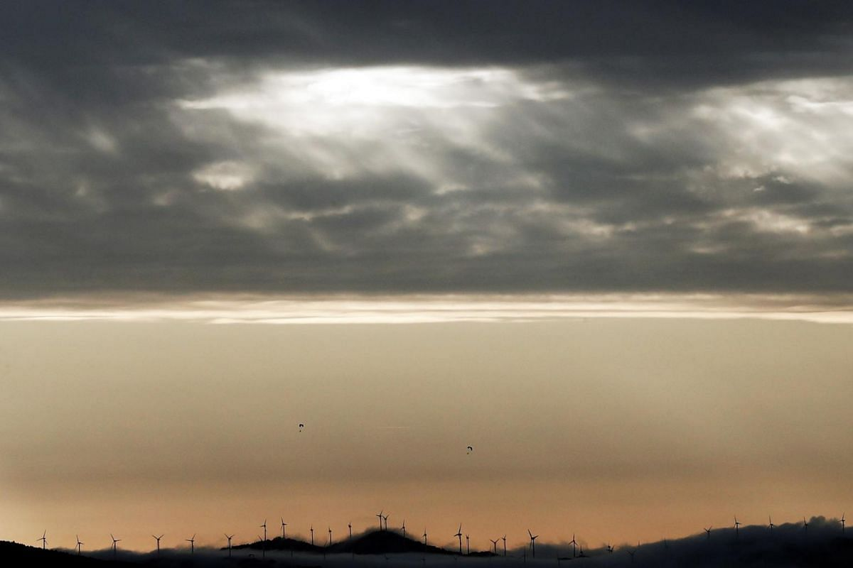 A view of sunlight peeping through clouds covering the sky over Pamplona, Navarra, Spain, on Dec 1, 2019.