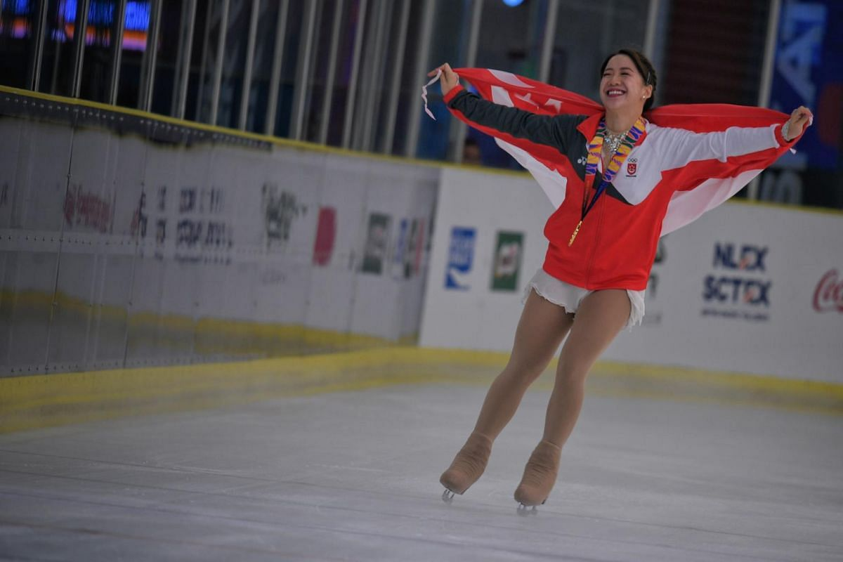 Singapore figure skater Chloe Ing celebrates with her gold medal and the Singapore flag at the 30th SEA Games in Manila, on Dec 1, 2019.