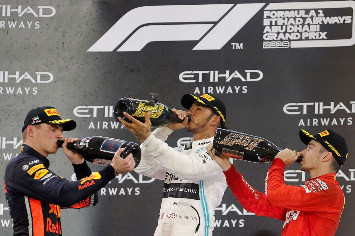 Mercedes' Lewis Hamilton celebrates after winning the race with second placed Red Bull's Max Verstappen and third placed Ferrari's Charles Leclerc at the Formula One F1 Abu Dhabi Grand Prix in Abu Dhabi, United Arab Emirates on Dec 1, 2019. PHOTO: RE
