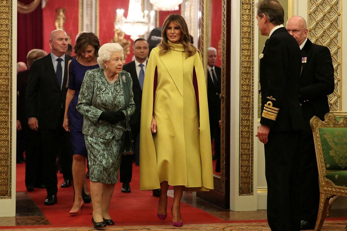 Britain's Queen Elizabeth walks with U.S. first lady Melania Trump during a reception to mark 70 years of the NATO Alliance, hosted by Britain's Queen Elizabeth, at Buckingham Palace, in London, Britain, December 3, 2019. PHOTO: REUTERS