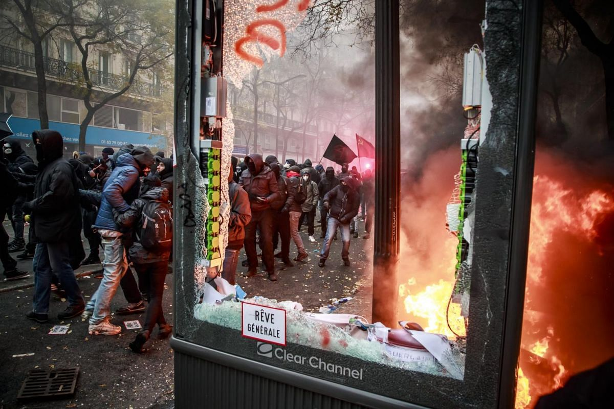 Protesters clash with French riot police during a demonstration against pension reforms in Paris, France, on Dec 5, 2019.