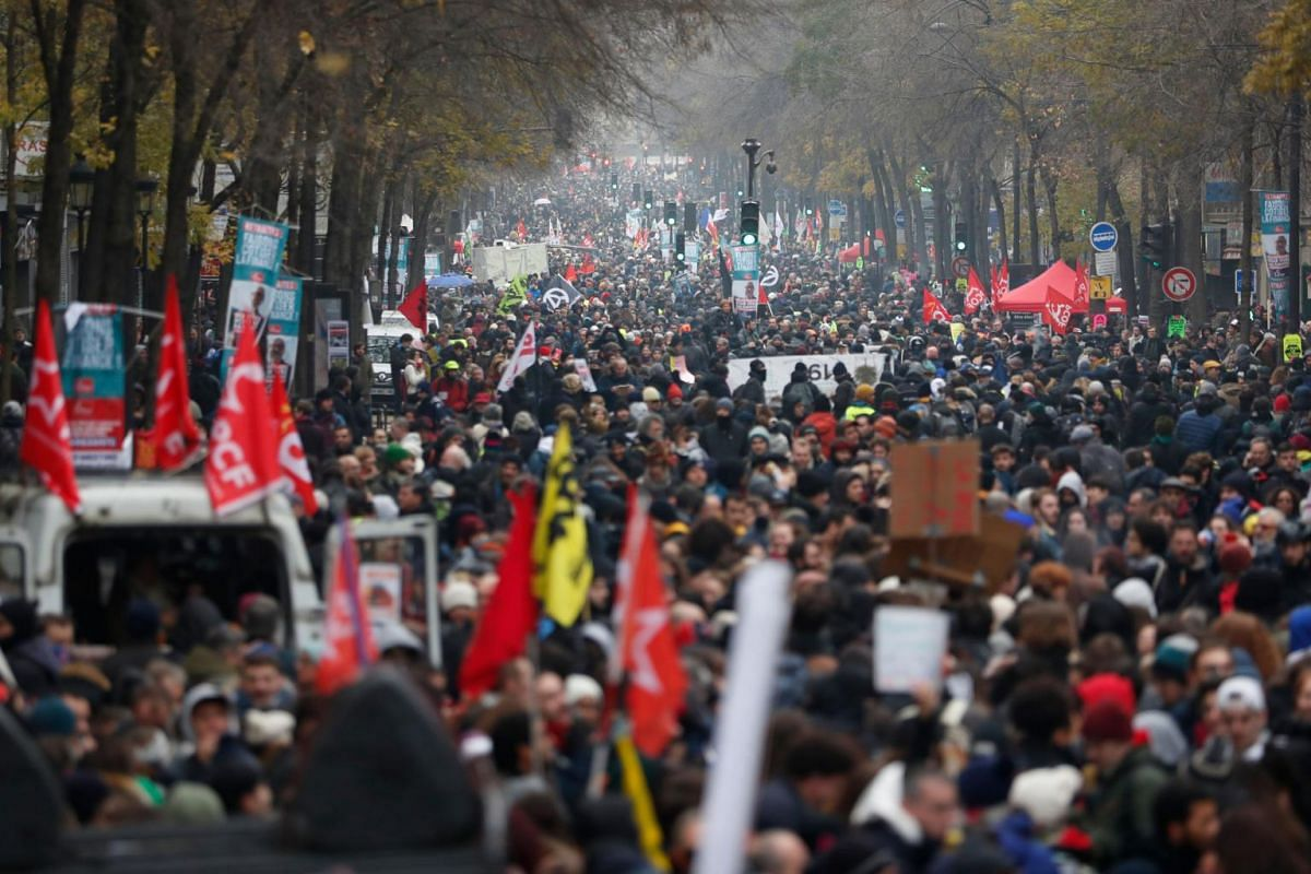 People take part in a demonstration against the pension overhauls in Paris, on Dec 5, 2019.