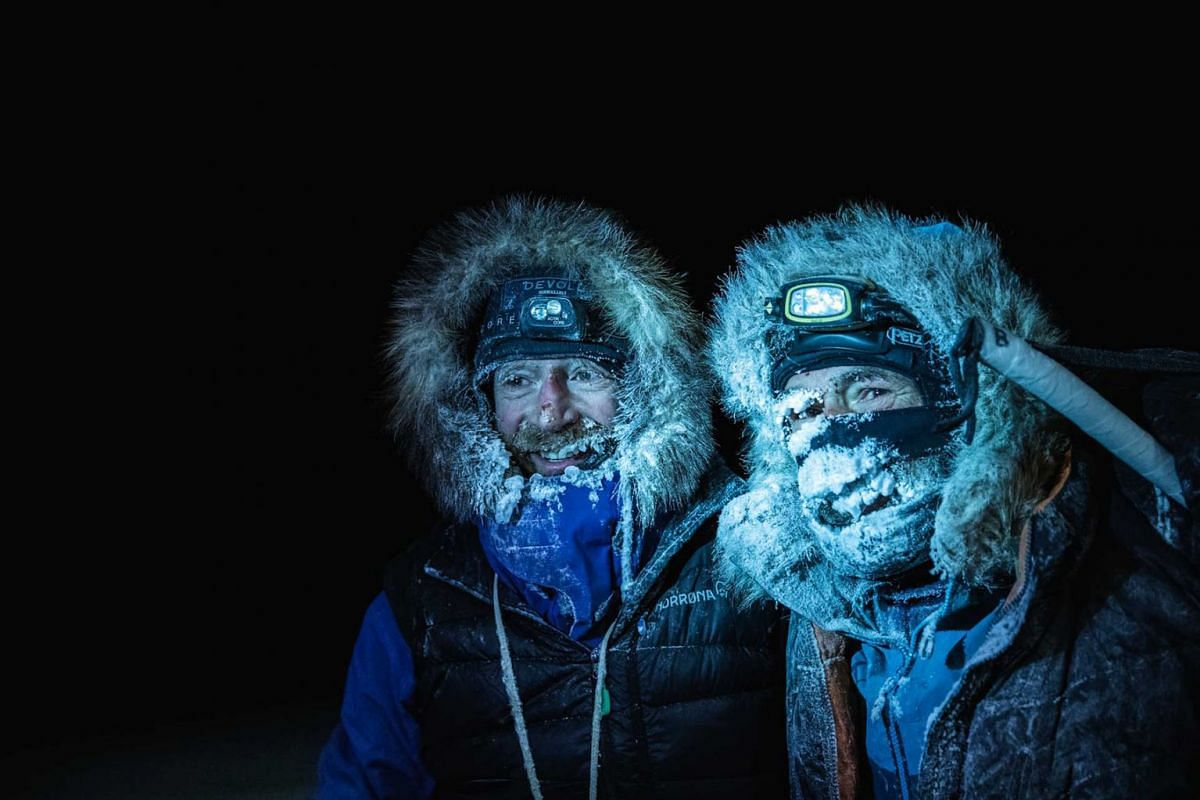 A handout photo shows Borge Ousland (L) of Norway and South African-born Swiss Mike Horn posing on December 8, 2019 after arriving at the Lance icebreaker boat in Norwegian waters of the Arctic Ocean, after succesfully crossing the Arctic Ocean on sk