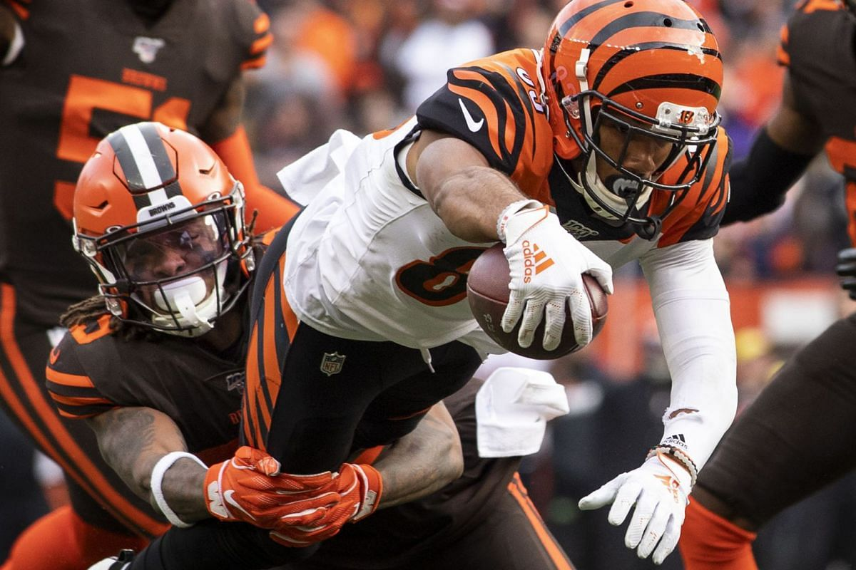 Cincinnati Bengals wide receiver Tyler Boyd (83) dives as Cleveland Browns defensive back Sheldrick Redwine (29) tackles him short of the goal line during the second quarter at FirstEnergy Stadium on Dec 8, 2019 in Cleveland, OH, USA. PHOTO: USA TODA