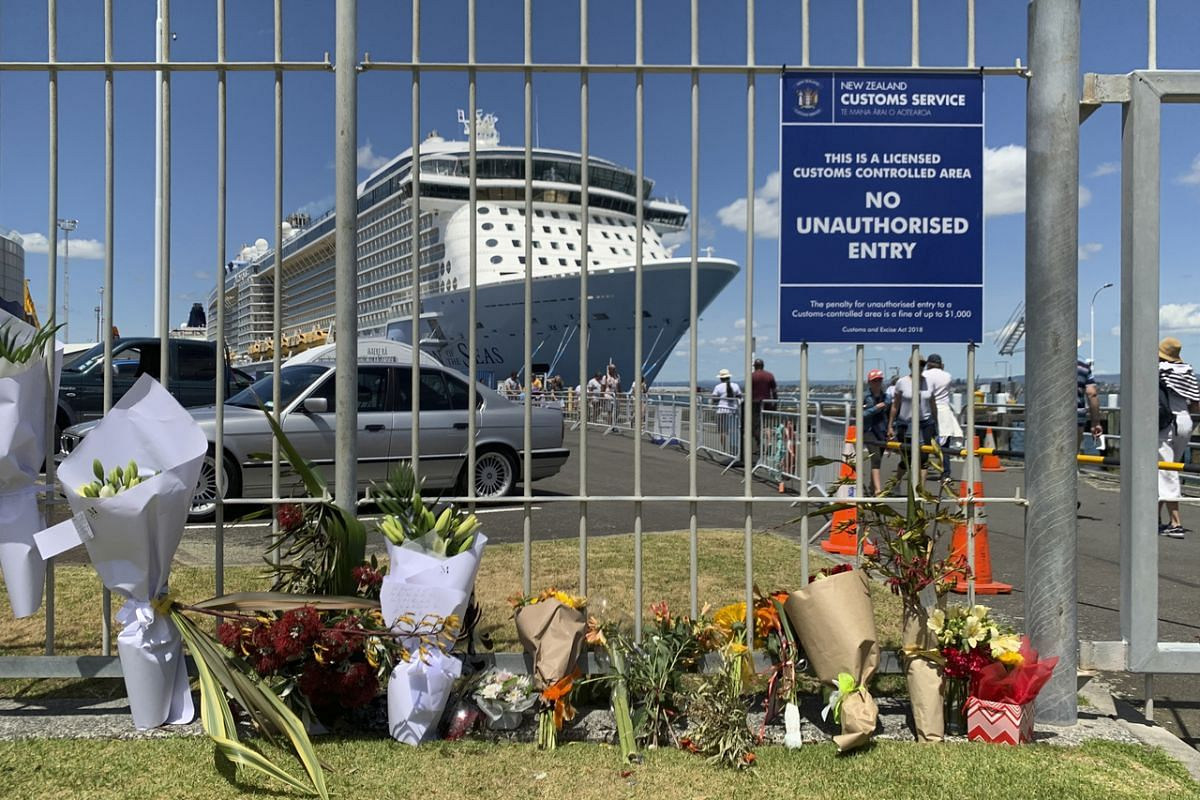 A makeshift memorial near where the cruise ship Ovation of the Seas is docked in Tauranga, New Zealand, on Dec 10, 2019. Many day tours visit White Island regularly, and the cruise liner was there at the time.