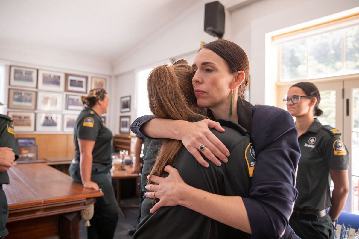 New Zealand Prime Minister Jacinda Ardern (right) at Whakatane Fire Station on Dec 10, 2019. She is hugging a first responder from the St John's ambulance team that helped those injured in the White Island volcano eruption the day before.
