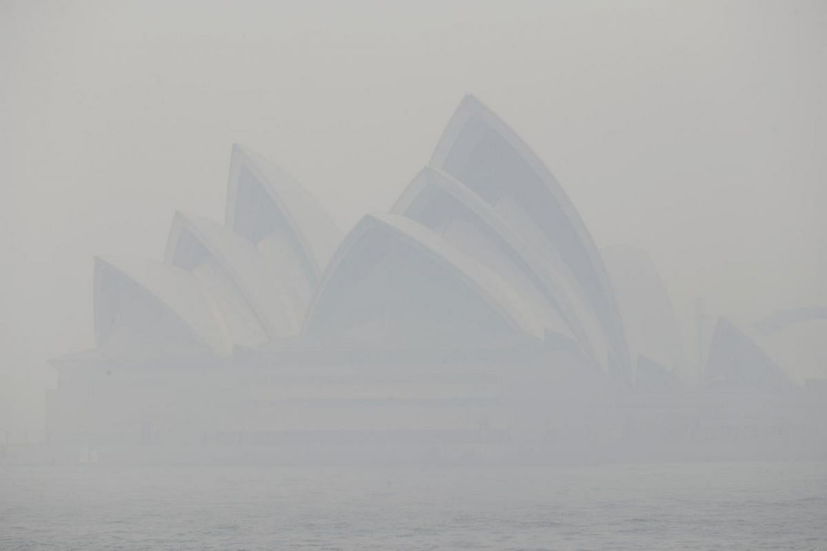 Thick smoke from wildfires shroud the Opera House in Sydney on Dec 10, 2019.