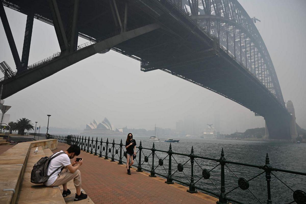 Tourists under the Sydney Harbour Bridge on Dec 10, 2019.