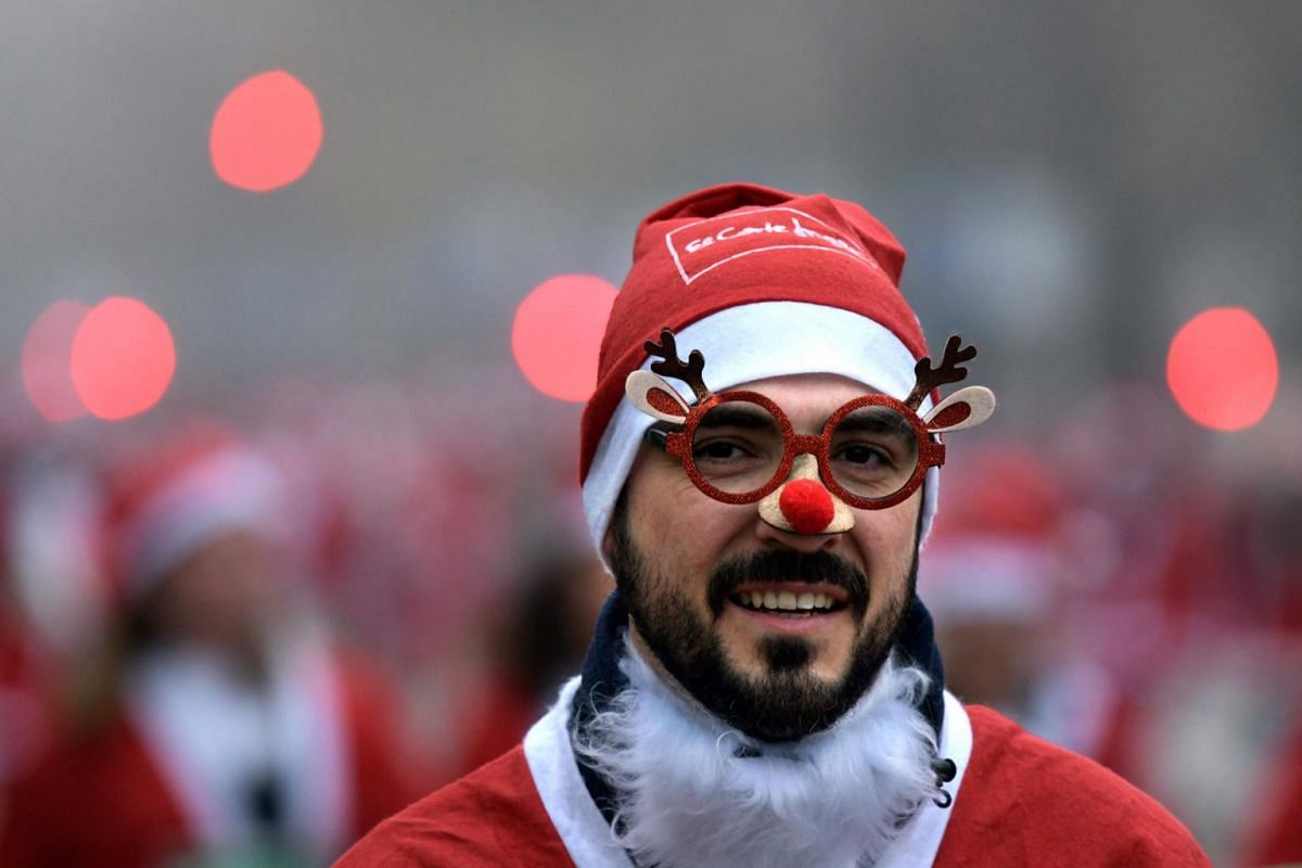 A man dressed as Santa Claus takes part in the traditional Santa Claus charity run, in Madrid, Spain, on Dec 8, 2019.