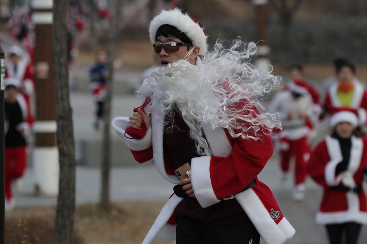 A participant takes part in the Santa Run 2019 event in Goyang, South Korea, on Dec 7, 2019.