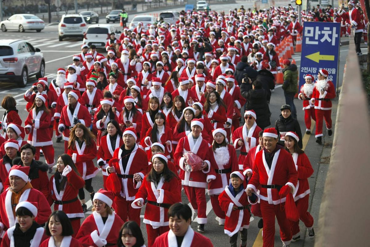 Participants dressed in Santa Claus outfits take part in the Santa Run 2019 marathon event in Goyang, South Korea, on Dec 7, 2019.