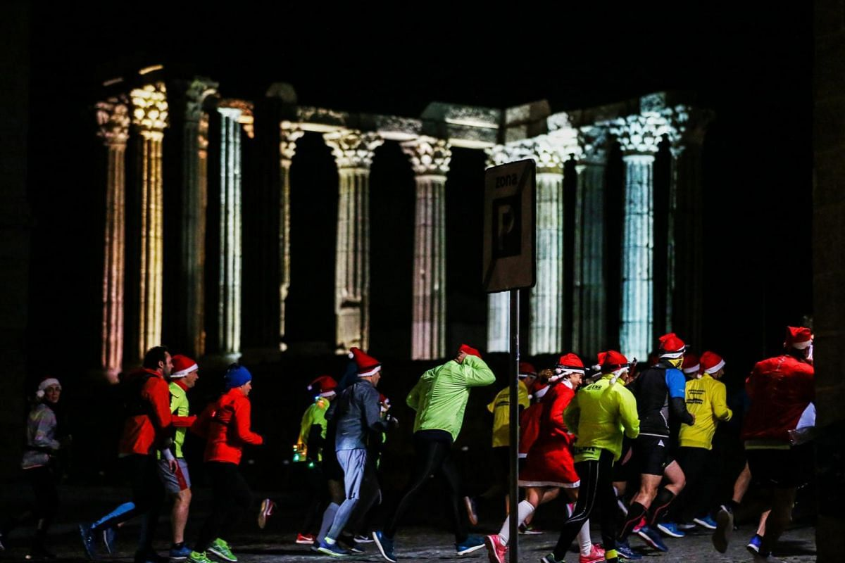 The Evora Night Runners group holds the fifth edition of the Father Christmas Run and Walk at Giraldo Square in Evora, Portugal, on Dec 11, 2019.