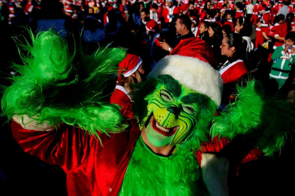 A participant dressed as the Grinch participates in the Run Santa Run Guadalajara annual Christmas race, in Guadalajara, Mexico, on Dec 8, 2019.