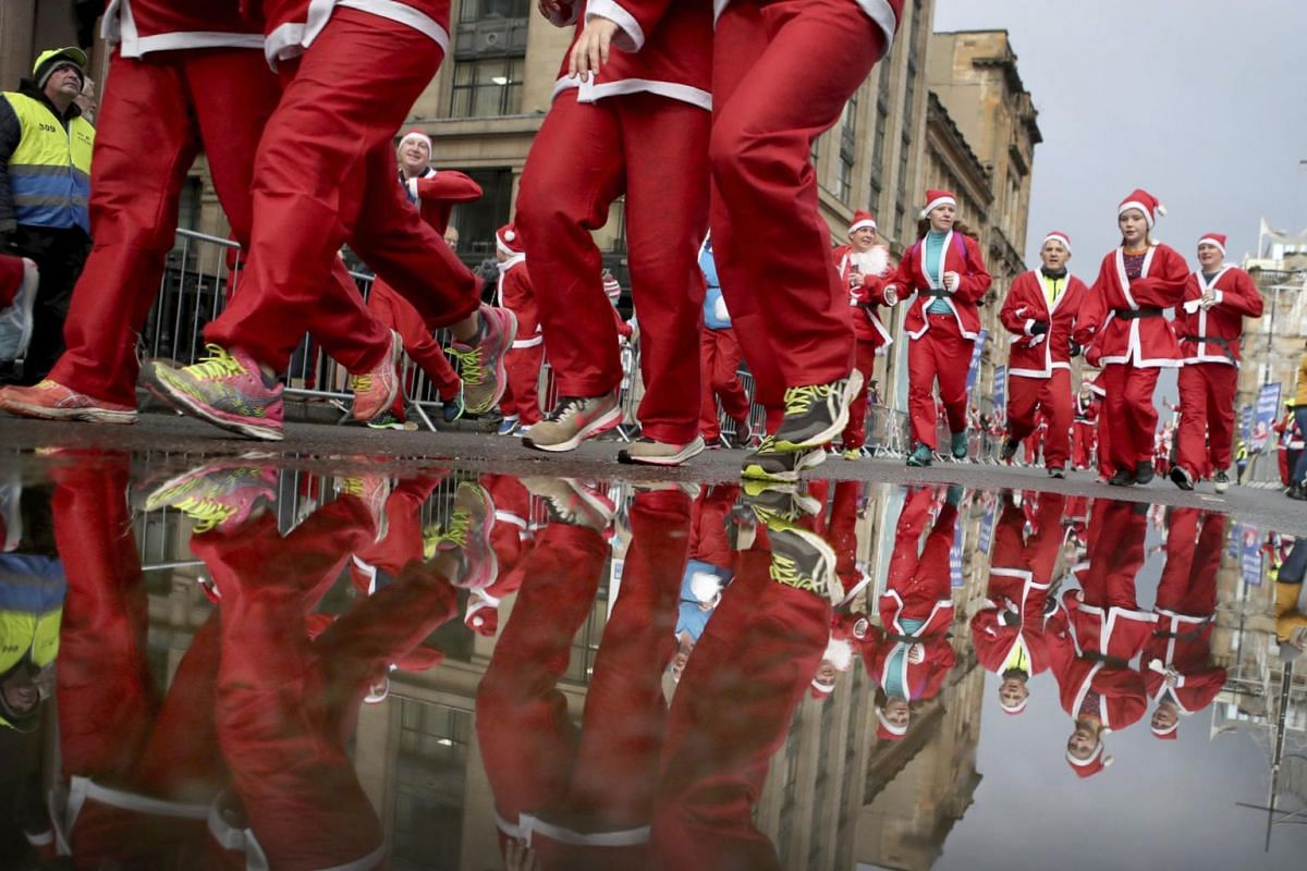 Participants run in the annual Christmas Santa Dash through the city centre in Glasgow, Scotland, on Dec 8, 2019.