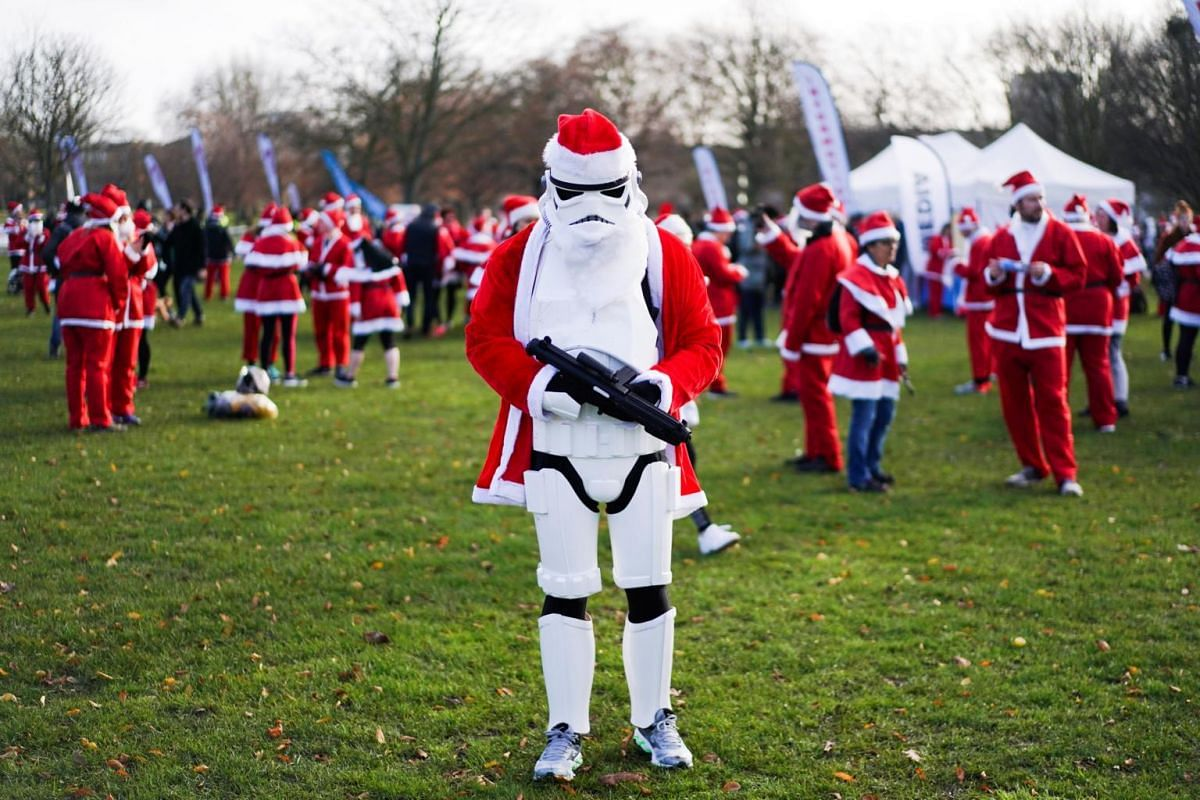 Competitors prepare to take part in the London Santa Run in Victoria Park, London, Britain, on Dec 8, 2019.