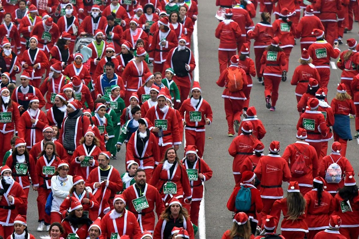 Participants take part in a Santa Claus charity run in Madrid, Spain, on Dec 8, 2019.