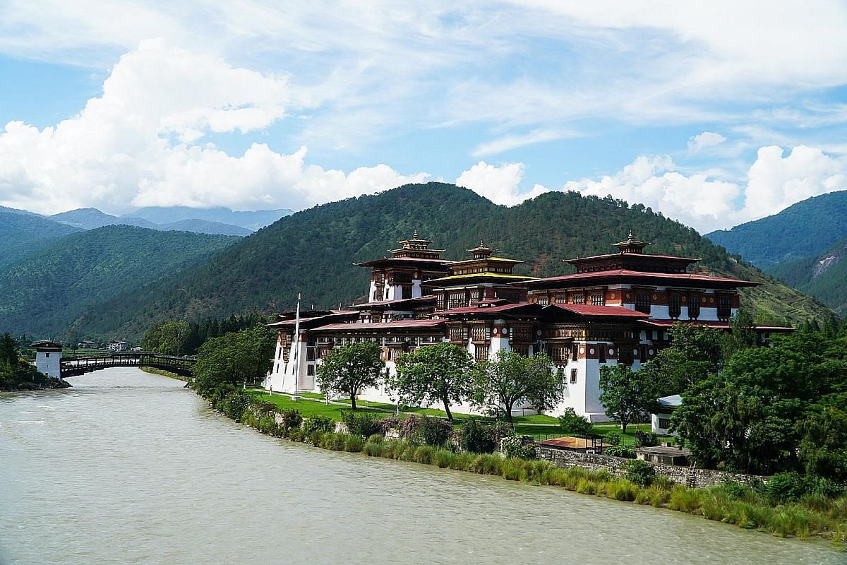 Punakha Dzong rises impressively from the banks of the Pho Chu and Mo Chu rivers.