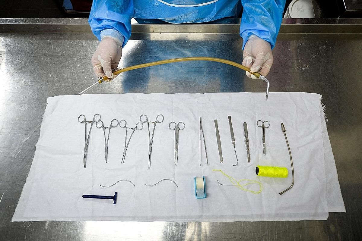 Some embalmers do restorative work on bodies that have been badly injured, such as in accidents and suicides. There are about 30 embalmers here. Some of the tools used in embalming. Besides pumping the embalming fluid into the deceased, embalmers als