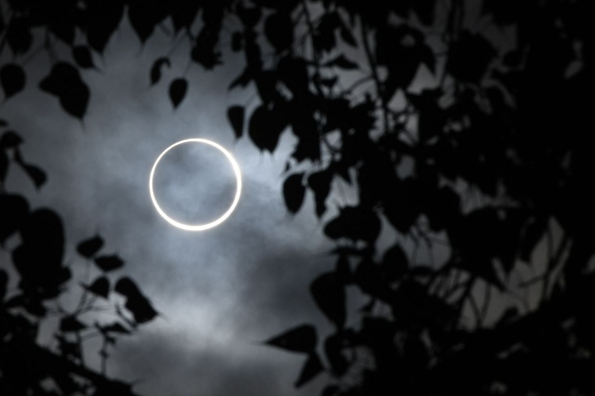"""The Moon totally covers the Sun in a rare """"ring of fire"""" solar eclipse as seen from the south Indian city of Dindigul in Tamil Nadu state on Dec 26, 2019."""