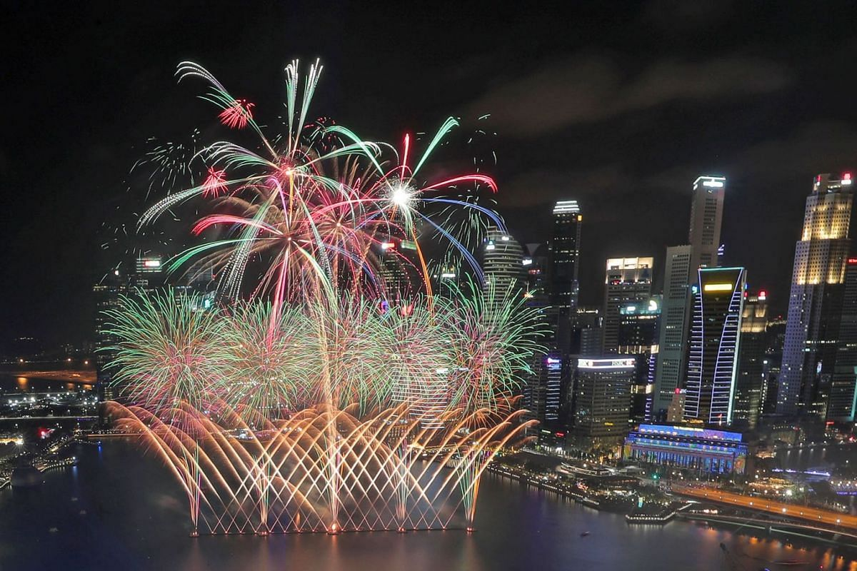 Fireworks display at the Marina Bay countdown celebration on Jan 1, 2020. Revellers thronged the bay area from as early as 3pm on Tuesday to be part of the festivities. PHOTO; THE STRAITS TIMES/JASON QUAH