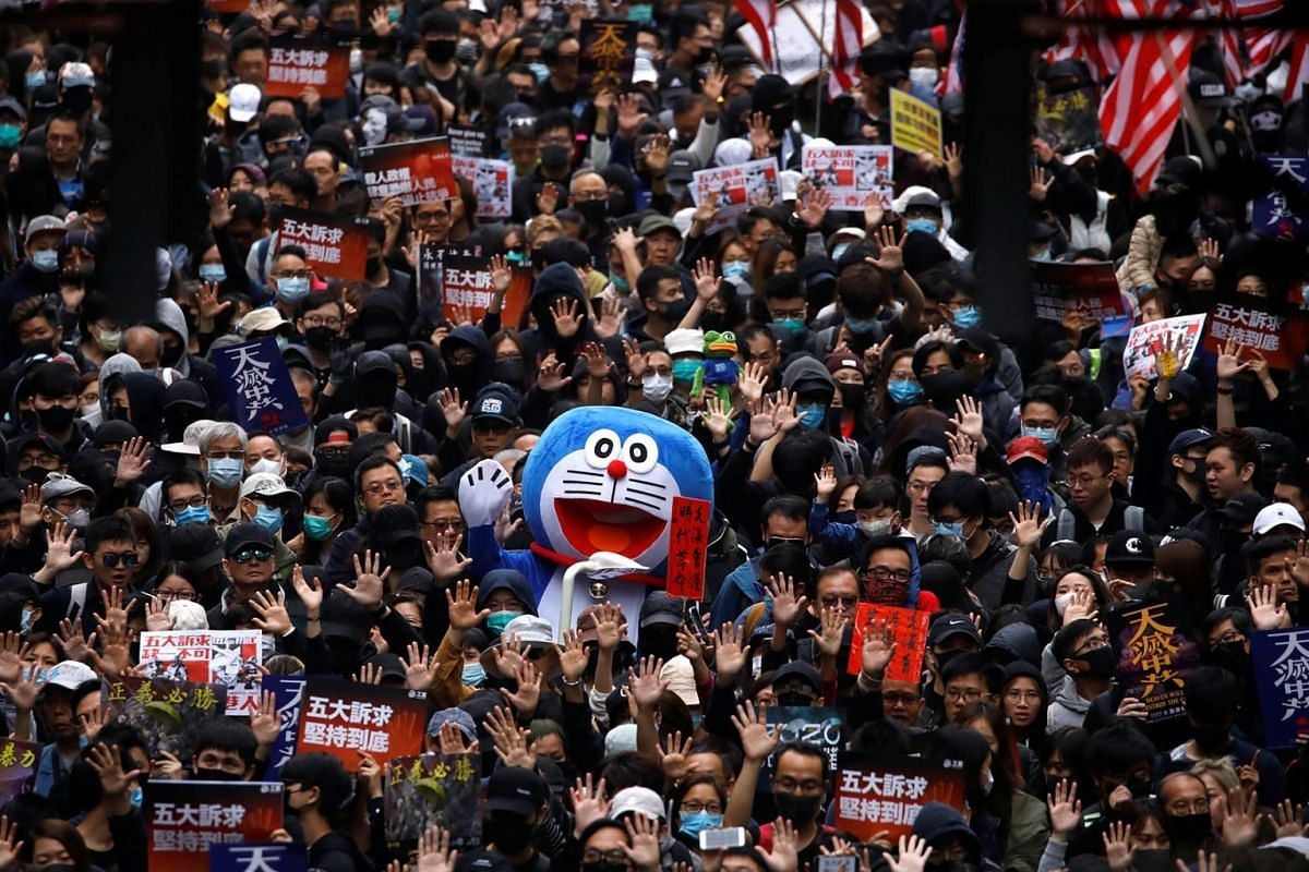 A person dressed in a costume of anime character Doraemon attends an anti-government demonstration on New Year's Day to call for better governance and democratic reforms in Hong Kong, China, January 1, 2020. PHOTO: REUTERS