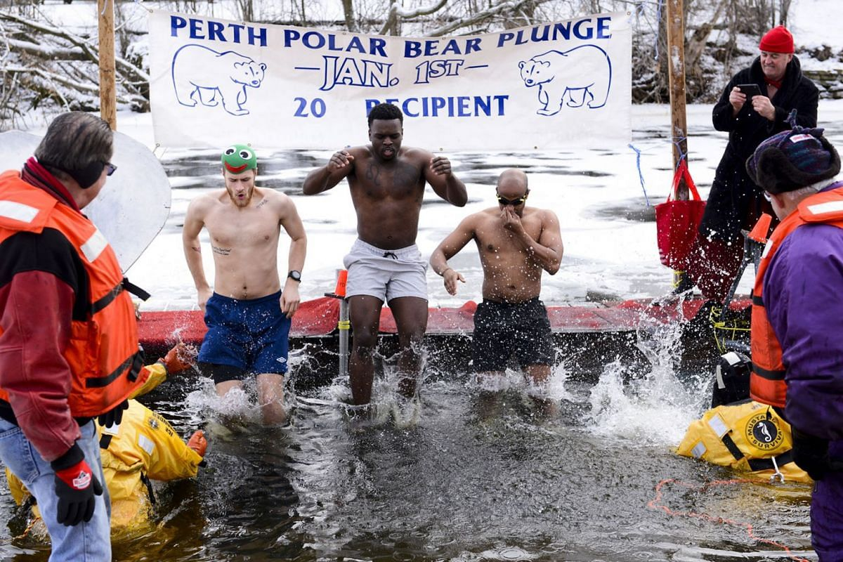 Polar Bear plungers bring in the New Year by jumping in the frigid waters of the Tay River in Perth, Ontario, Wednesday, Jan. 1, 2020. PHOTO: THE CANADIAN PRESS VIA AP