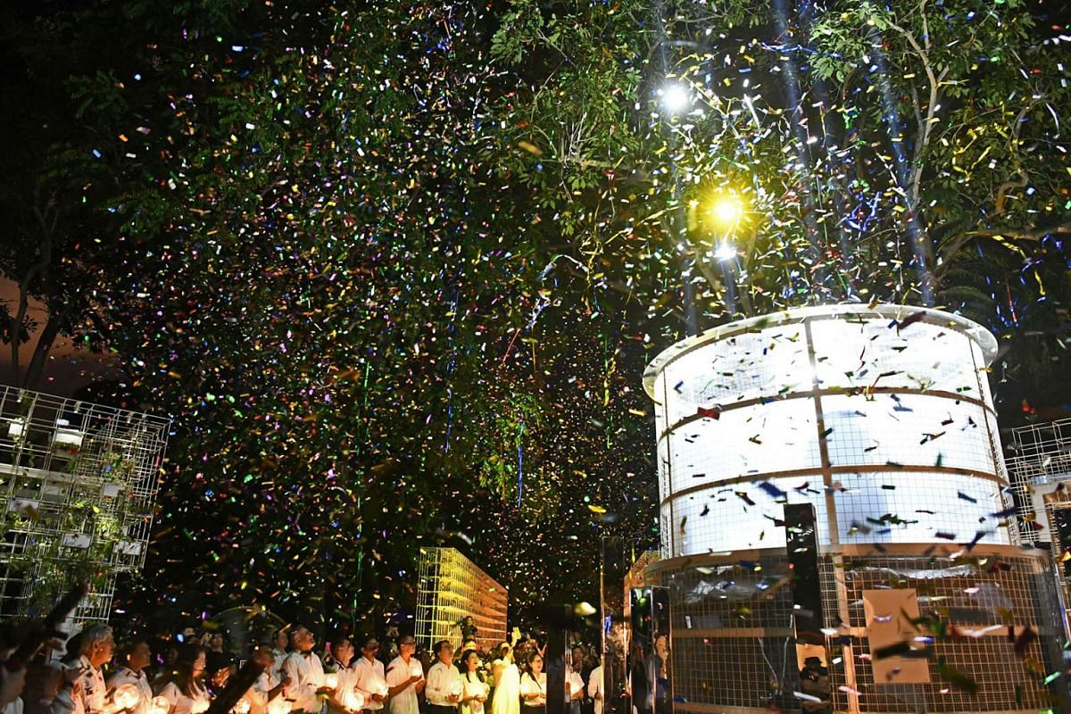 Those who worked on and helped out at The Bicentennial Experience celebrating the end of the show with a bang at its final curtain call on New Year's Eve on Dec 31, 2019. PHOTO: THE STRAITS TIMES/DESMOND FOO