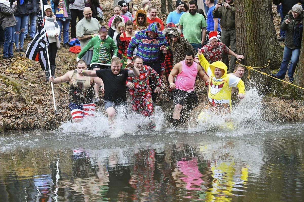 Thrillseekers take the leap during the Pine Creek Polar Bear Plunge in Valley View Park, Pennsylvania.