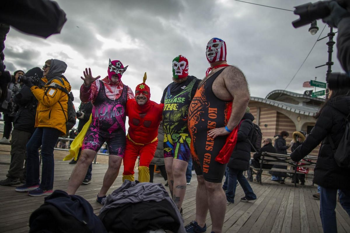 Revellers arriving for the Polar Bear plunge on Coney Island in the Brooklyn borough of New York City.