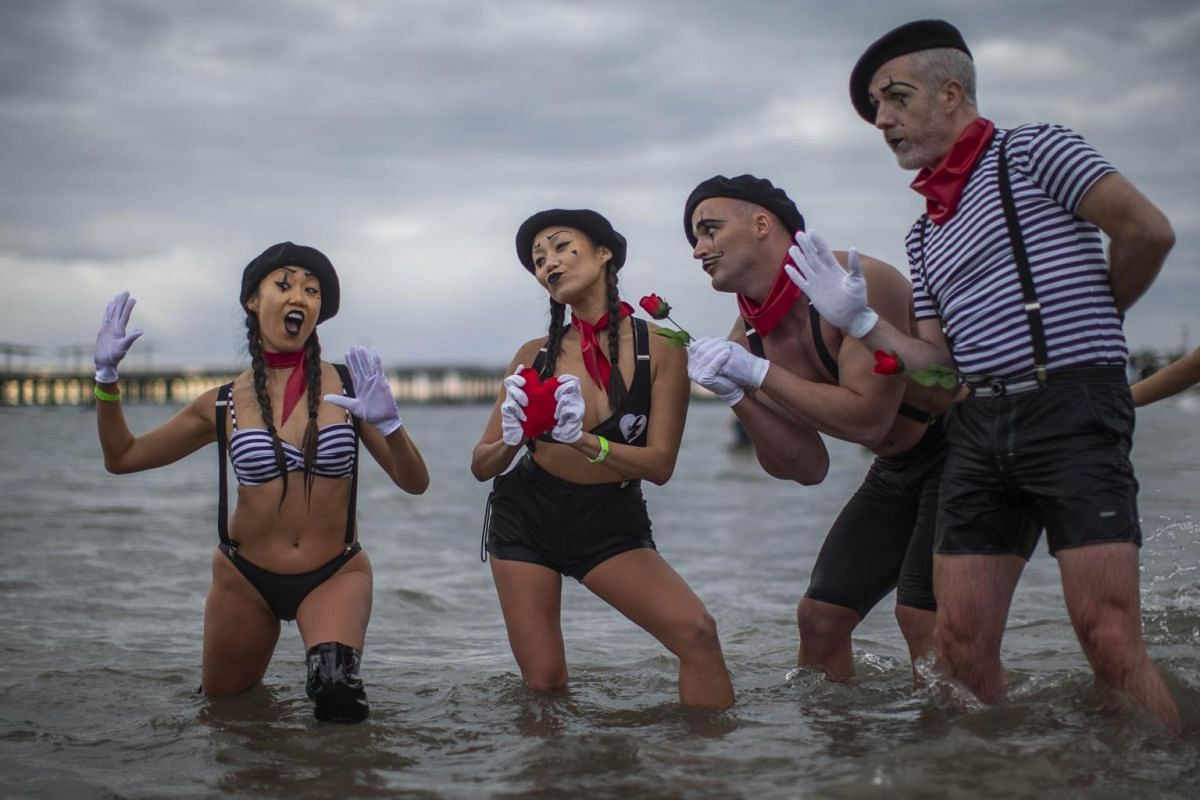 People dressed as mimes taking part in the Polar Bear plunge on Coney Island.