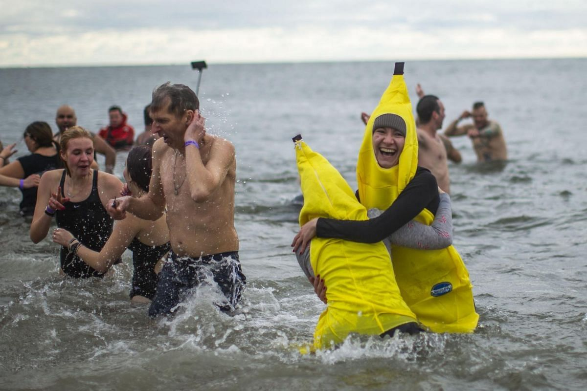 Participants in banana costumes join other revellers in the Polar Bear plunge on Coney Island.