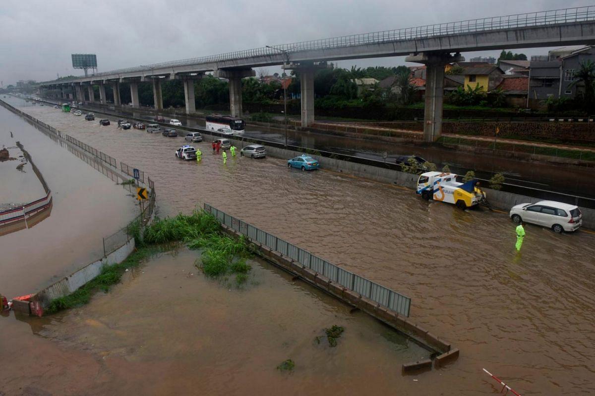 A road is flooded after heavy rain in Bekasi, near Jakarta, Indonesia, on Jan 1, 2020.