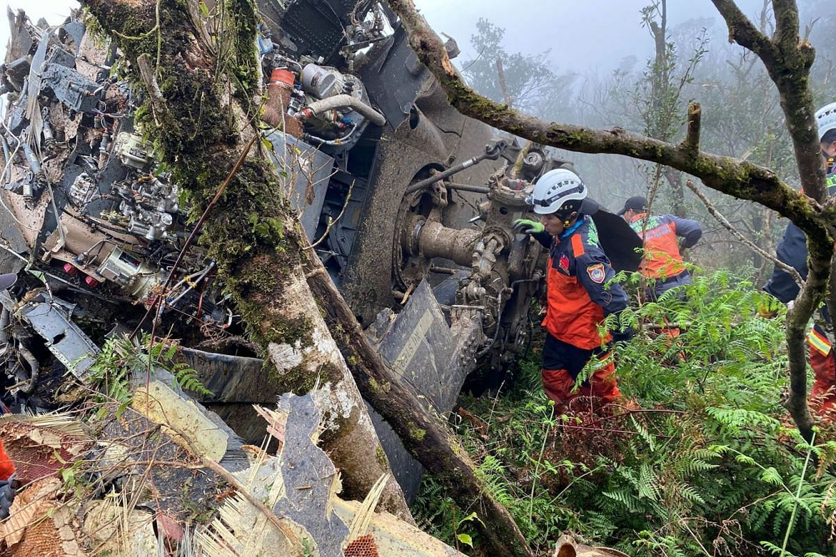 A rescue team searches for missing military officers, after a Black Hawk helicopter made a forced landing at a mountainous area near Taipei, Taiwan January 2, 2020. PHOTO: YILAN COUNTY FIRE BUREAU VIA REUTERS
