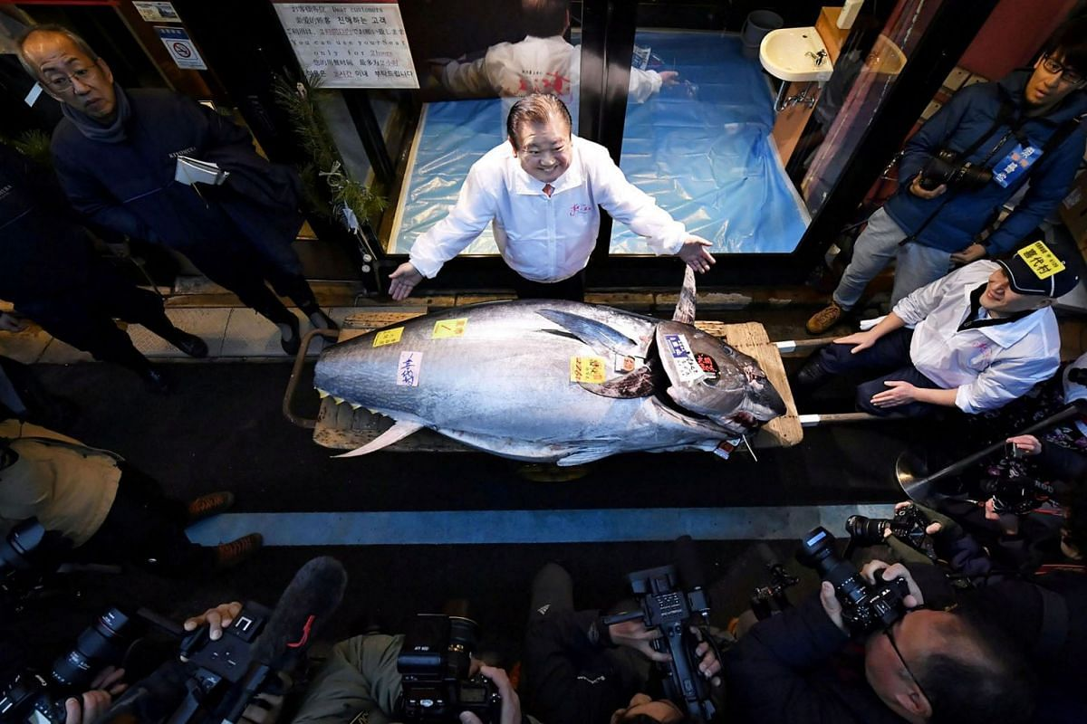 Kiyoshi Kimura, president of Kiyomura Corp., operator of Japanese sushi chain Sushizanmai, poses with a bluefin tuna that was auctioned for 193 million Japanese yen (about S$2.4 million) in Tokyo, Japan, Jan 5, 2020.