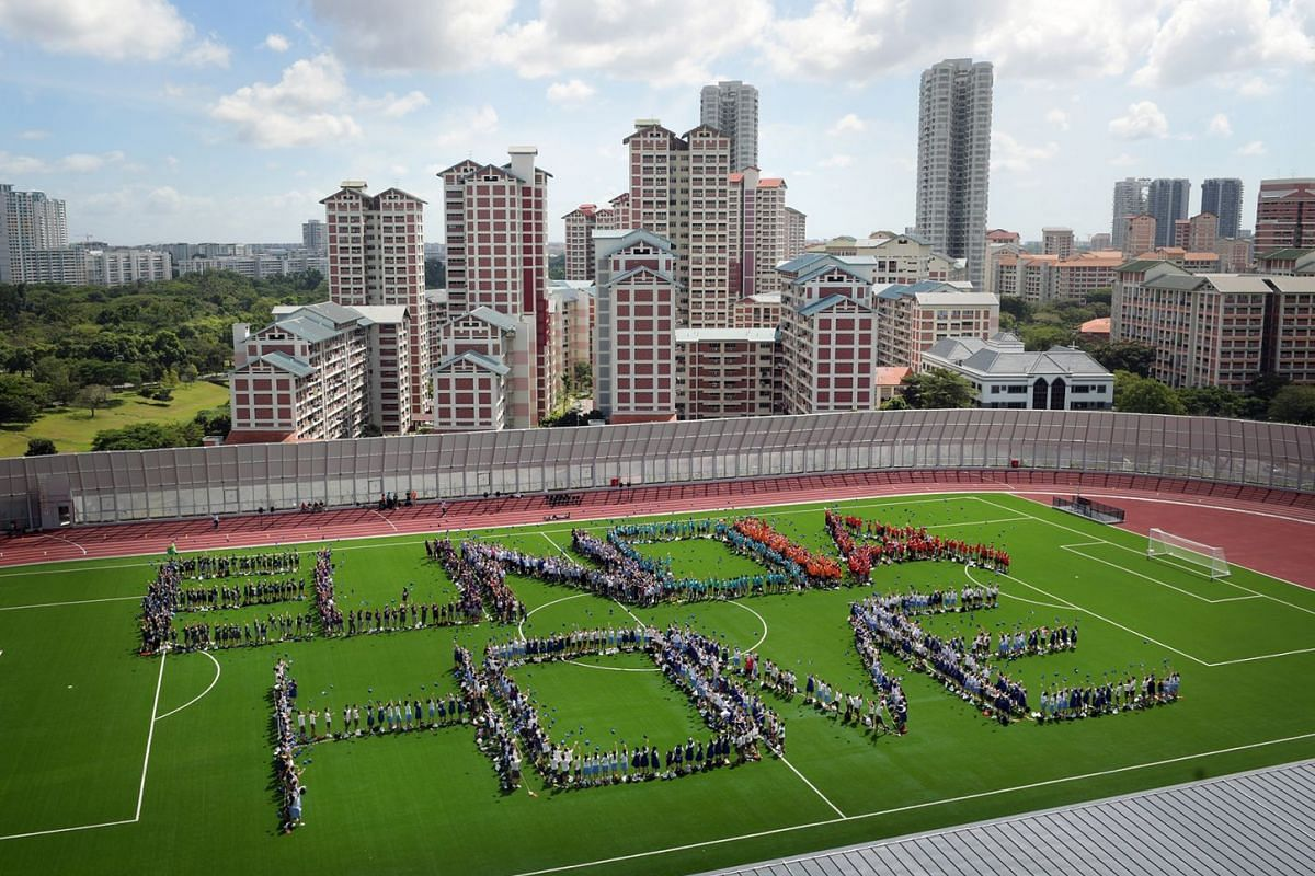 """Students from Eunoia Junior College converged on the school field to form the words """"Eunoia Home"""", as part of the ceremony to mark the new academic year and the JC's move from its former Mount Sinai Road campus to Sin Ming Avenue in Bishan on J"""