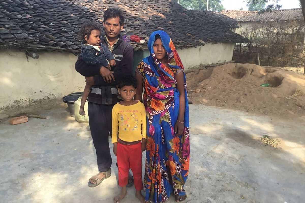 NANHELAL KOL AND FAMILY: Mr Nanhelal Kol with his wife and daughters, aged two and five, outside their home in Mahilokhar. He works as a daily wage worker in different cities and earns just enough to keep his family afloat. He would like his daughter