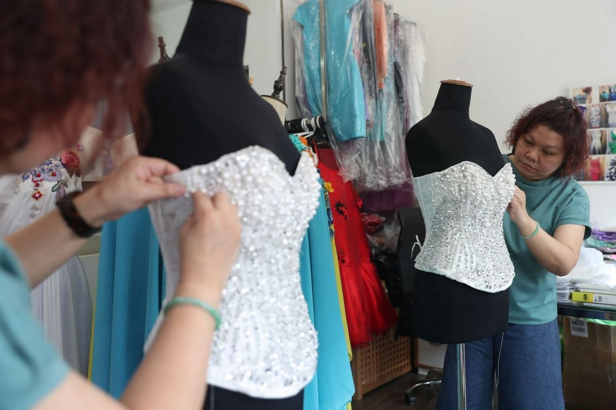 Bridalwear designer Suzanne Chua runs an atelier, Zann & Denn's, with her husband Dennis Koh, where she also tailors sharp suits and office wear.