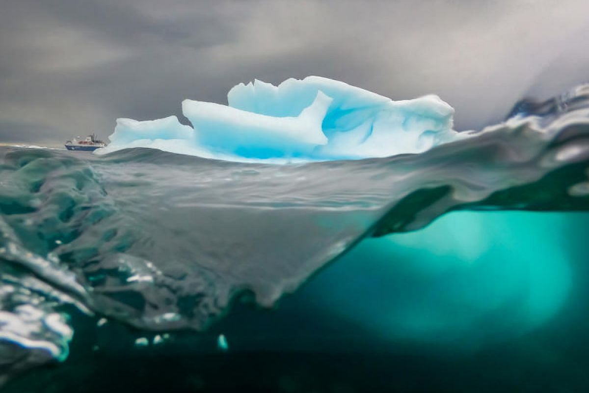 This dramatic shot of a sculptural iceberg – with most of its mass hidden underwater – is the only successful one out of 900 taken in the difficult conditions of Antarctica. The expedition ship Ocean Atlantic can be seen in the background.