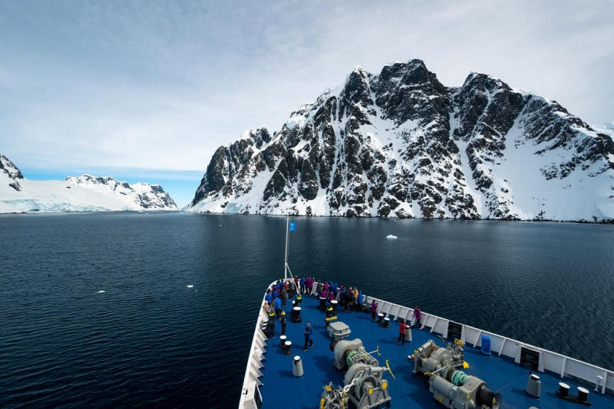 The Lemaire Channel is one of the most dramatic seascapes along the Antarctic Peninsula, with sheer rock faces towering above the water line in a narrow bay.