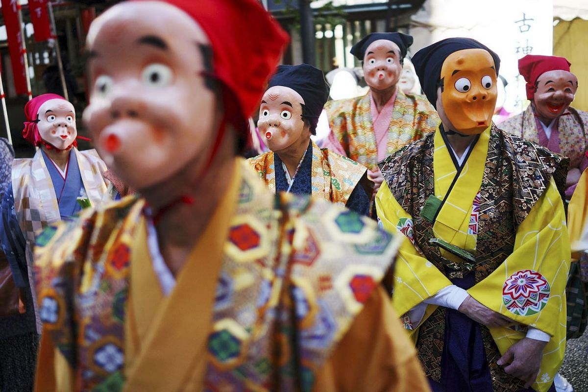 Artists wearing Japanese traditional clown masks stand for marching during the Konpira Festival at Kotohiragu shrine in Toranomon business district of Tokyo, Jan 10, 2020. The shrine is dedicated to sailors and seafaring.