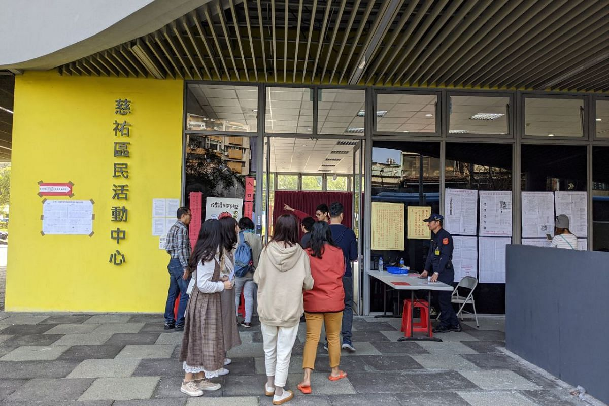 Voters line up to cast their ballots in Taiwan's general elections at a polling station in Taipei on Jan 11, 2020.
