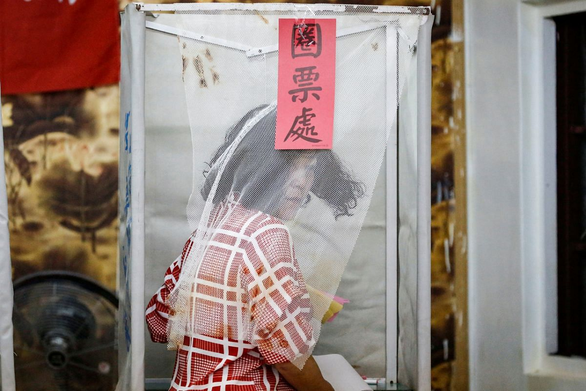 A Taiwanese voter is pictured at a polling booth during the general elections in Kaohsiung on Jan 11, 2020.