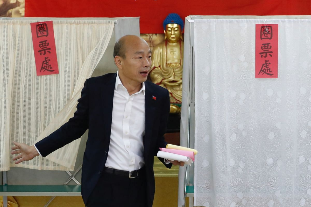 Taiwan's presidential election candidate Han Kuo-yu of the Nationalist Party prepares to cast his votes at a polling station in southern Taiwan's Kaohsiung city on Jan 11, 2020.