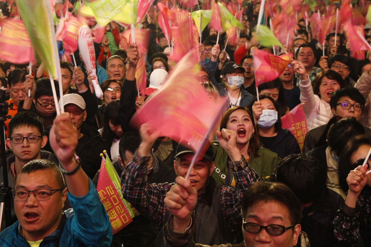 Supporters of Taiwan President Tsai Ing-wen cheer while following the online counting of ballots during the presidential election, in Taipei on Jan 11, 2020.