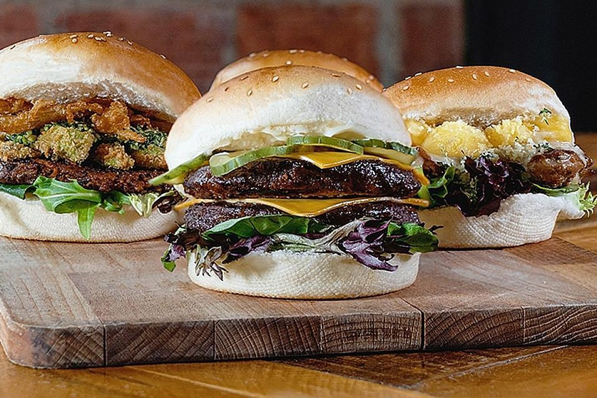 (From far left) The Flameshack's spicy bean burger, flame beef double and pina colada chicken burger.